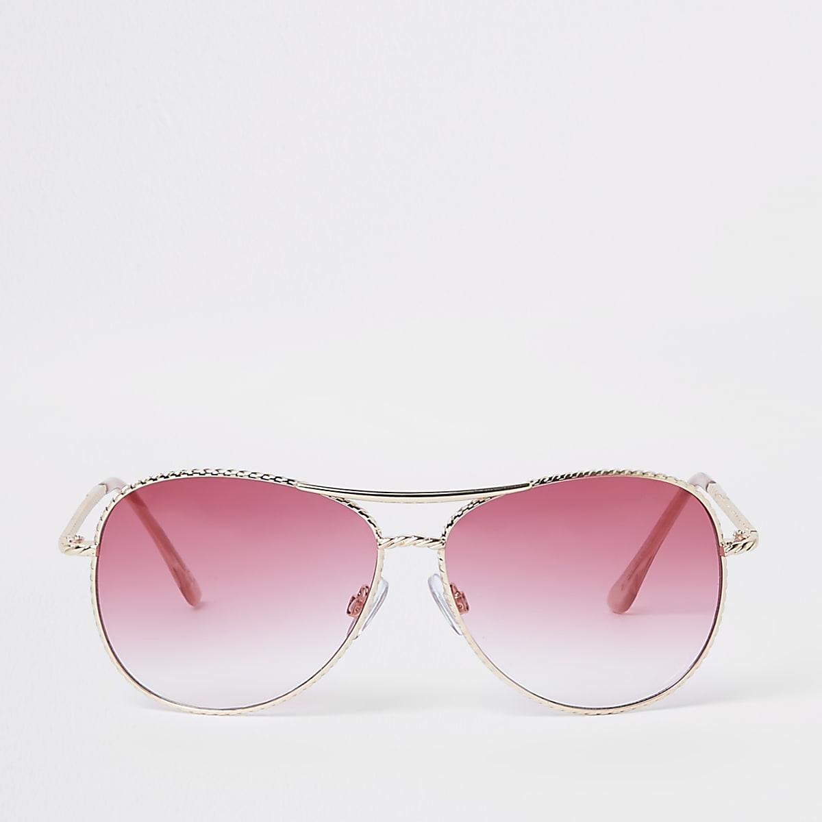 Goudkleurige gedraaide pilotenzonnebril met roze glazen