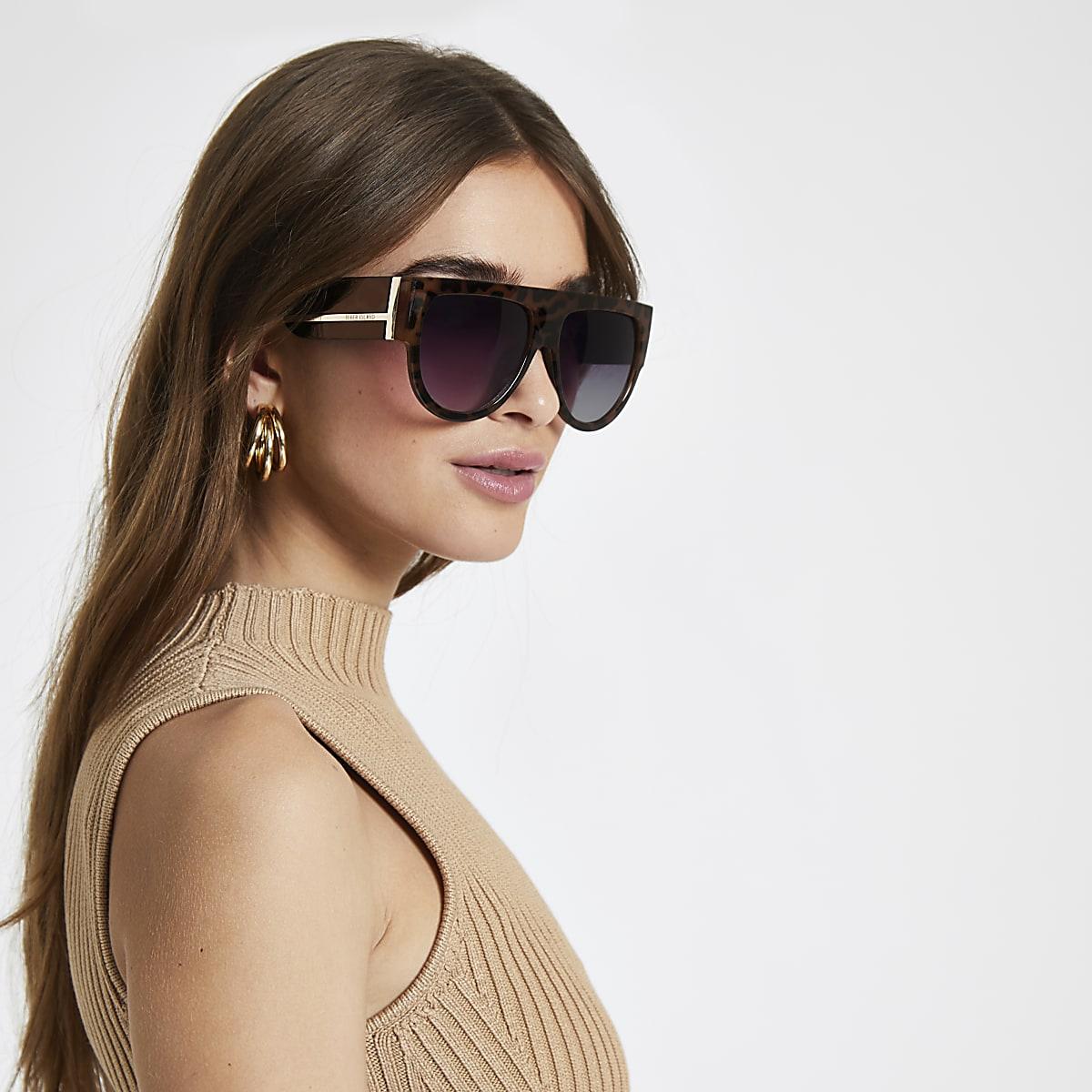 0bf3f75941914b Bruine tortoise visor zonnebril - Retro zonnebrillen - Zonnebrillen ...