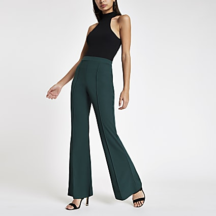 Green flared leg jersey trousers