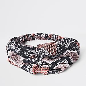 Roze gedraaide haarband met slangenprint