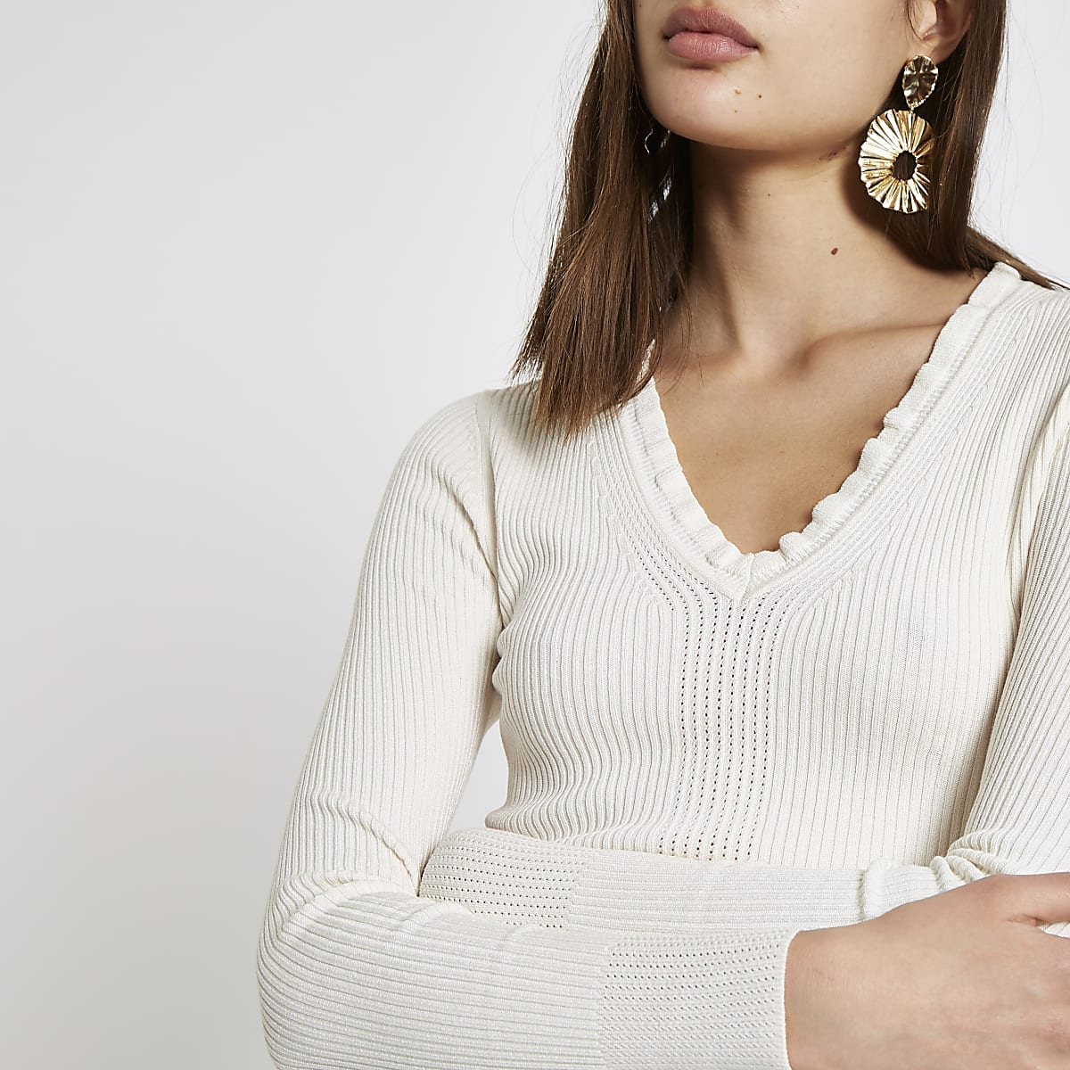 Cream ribbed knit V neck frill top