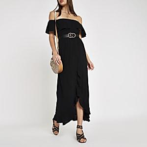 fff231cc56ef78 Zwarte gesmokte maxi-jurk in bardotstijl