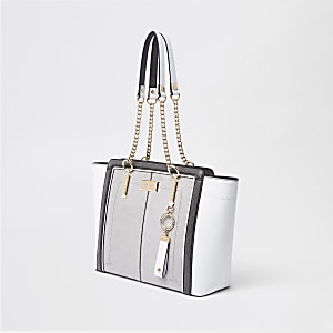 Light grey winged chain handle tote bag
