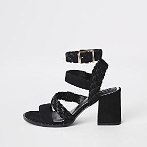 Zwarte leren geweven sandalen met studs en brede pasvorm