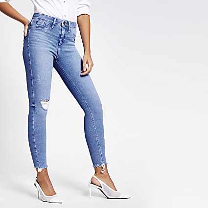 Bright blue ripped raw hem Molly jeggings