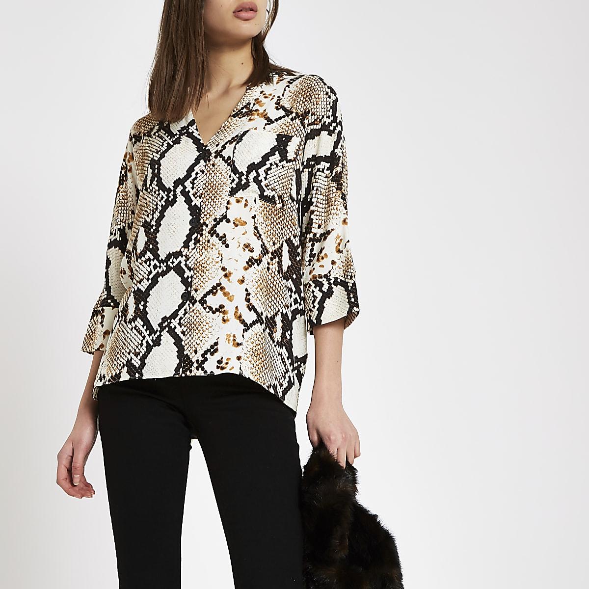 Bruine oversized blouse met slangenprint en knopen