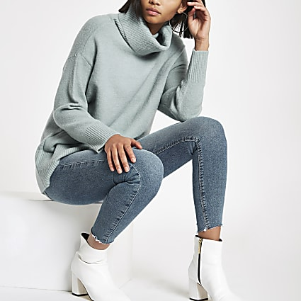 Green oversized roll neck jumper