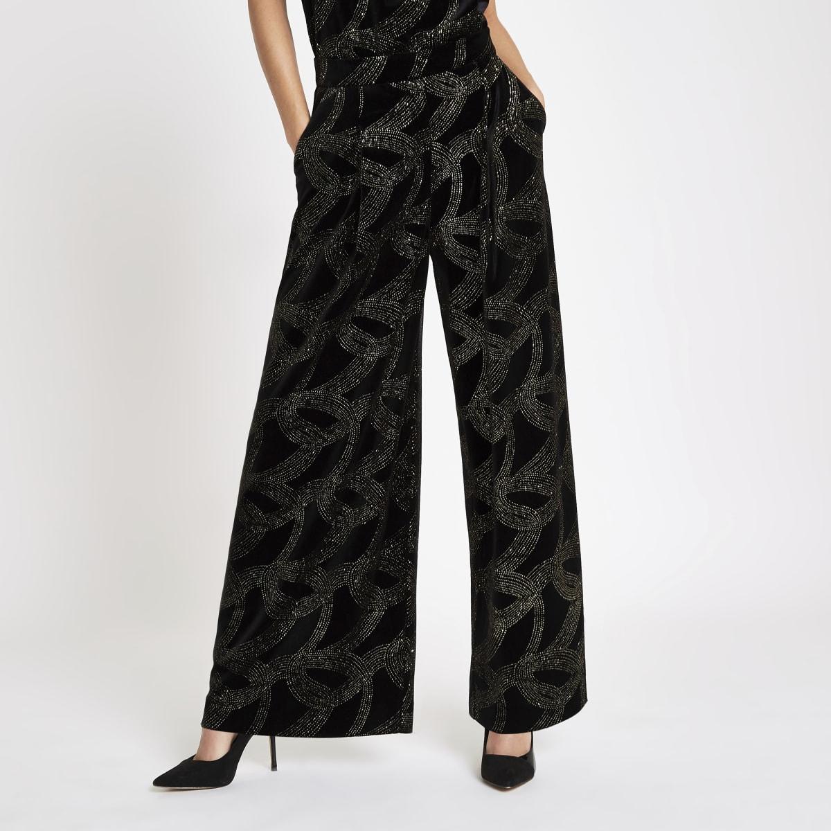 Zwarte broek met wijde pijpen en glitter