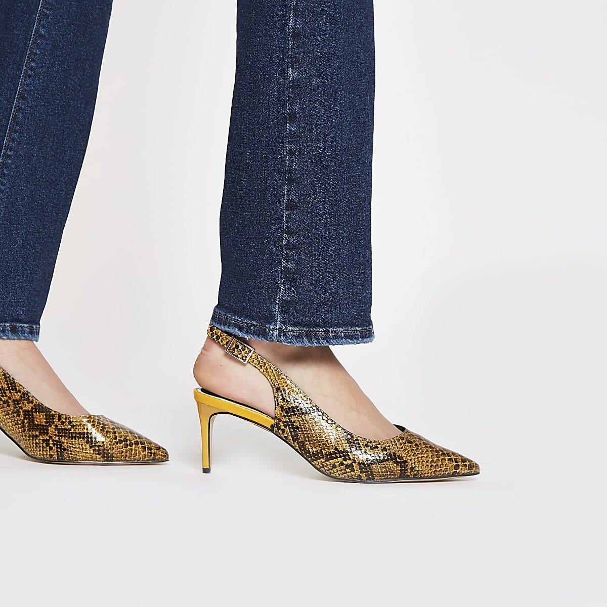 7754a9dd811 Yellow snake wide fit slingback court shoes