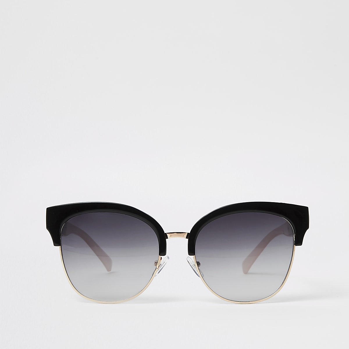 Goudkleurige oversized pilotenzonnebril met zwarte glazen