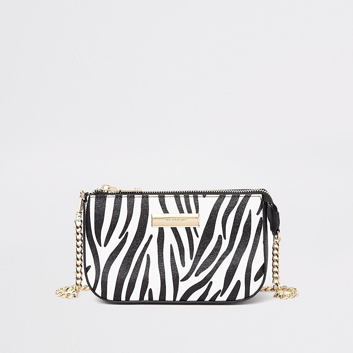 Kleine zwarte schoudertas met zebraprint en ketting