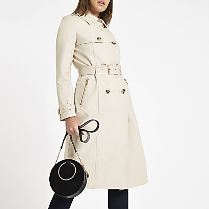 Beige double breasted belted trench coat
