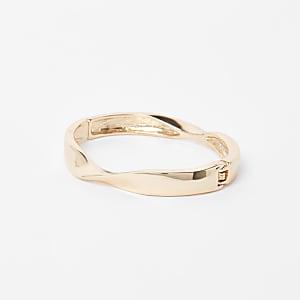 Goudkleurige gedraaide brede armband