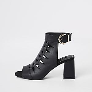 Zwarte laarzen met brede pasvorm en uitsnede