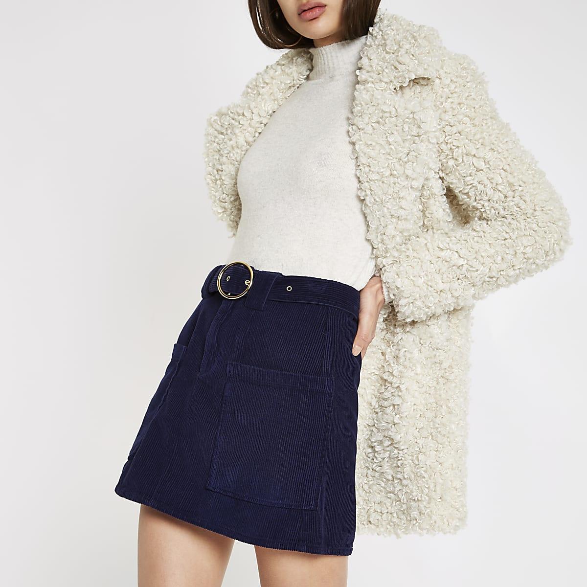 Mini-jupe en velours bleu marine avec ceinture