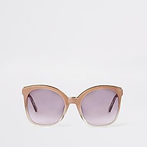 Grosses lunettes de soleil glamour roses