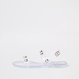 Transparente, strassverzierte Gummisandalen