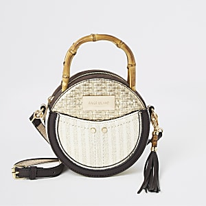Beige bamboo handle circle cross body bag
