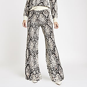 Cream knit snake print wide leg pants