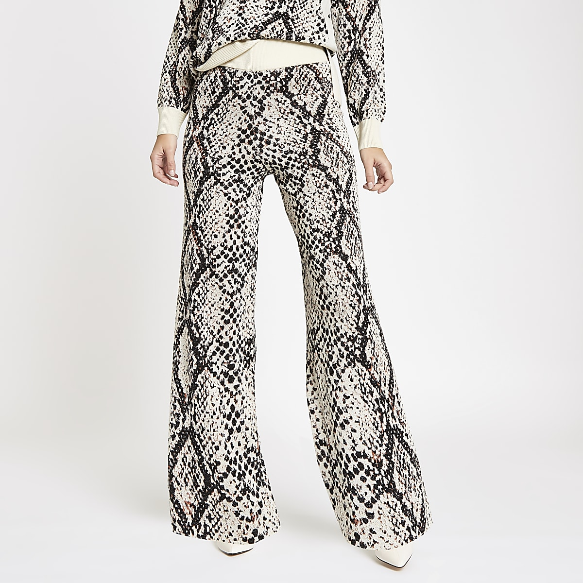 Cream knit snake print wide leg trousers