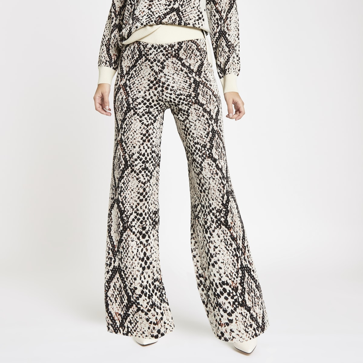 Cream knit snake print wide leg trousers