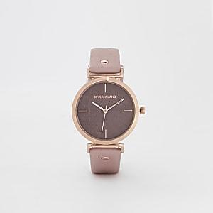 Roze horloge met roségoudkleurige wijzerplaat met RI-logo