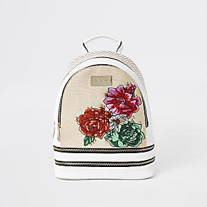 Sac à dos blanc à double zip avec motif fleuri brodé