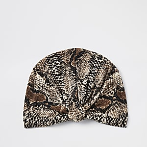 Beige hoofdband met slangenprint