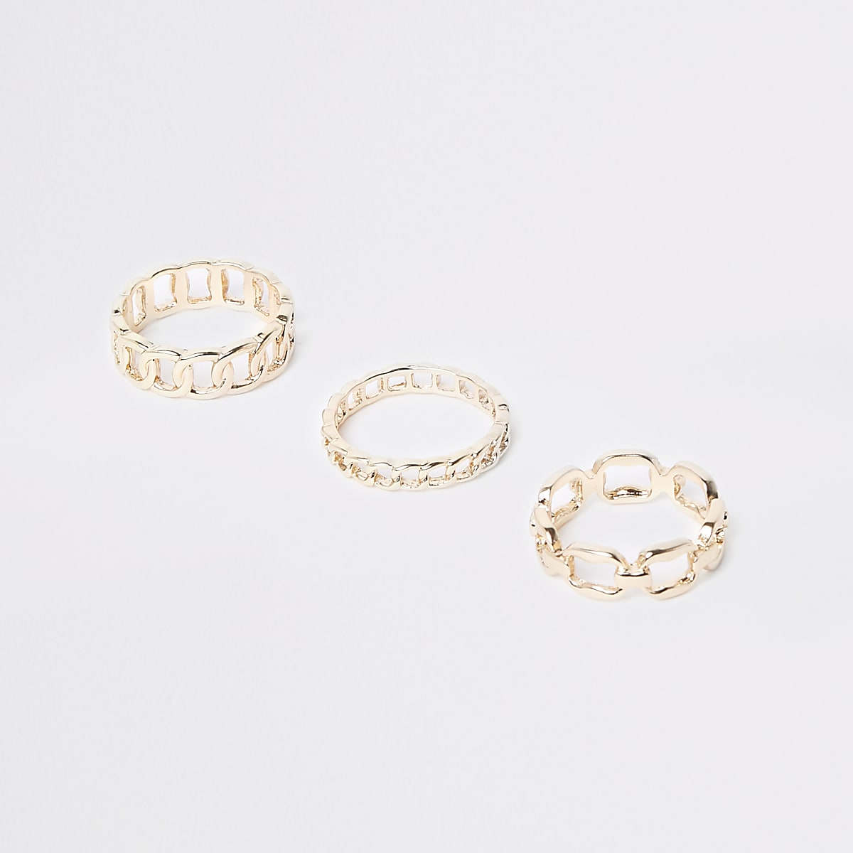 Gold colour curb chain ring pack