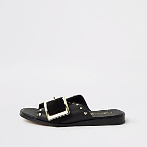 Zwarte leren platte sandalen met gesp