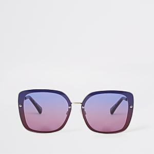 Goudkleurige glamoureuze zonnebril met blauwe ombre glazen