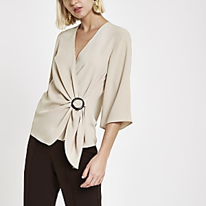 Beige wrap front horn ring blouse