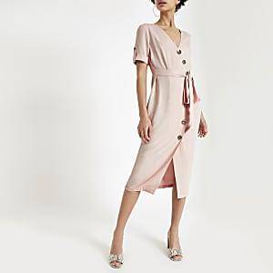 Pinkes Minikleid mit Knopf