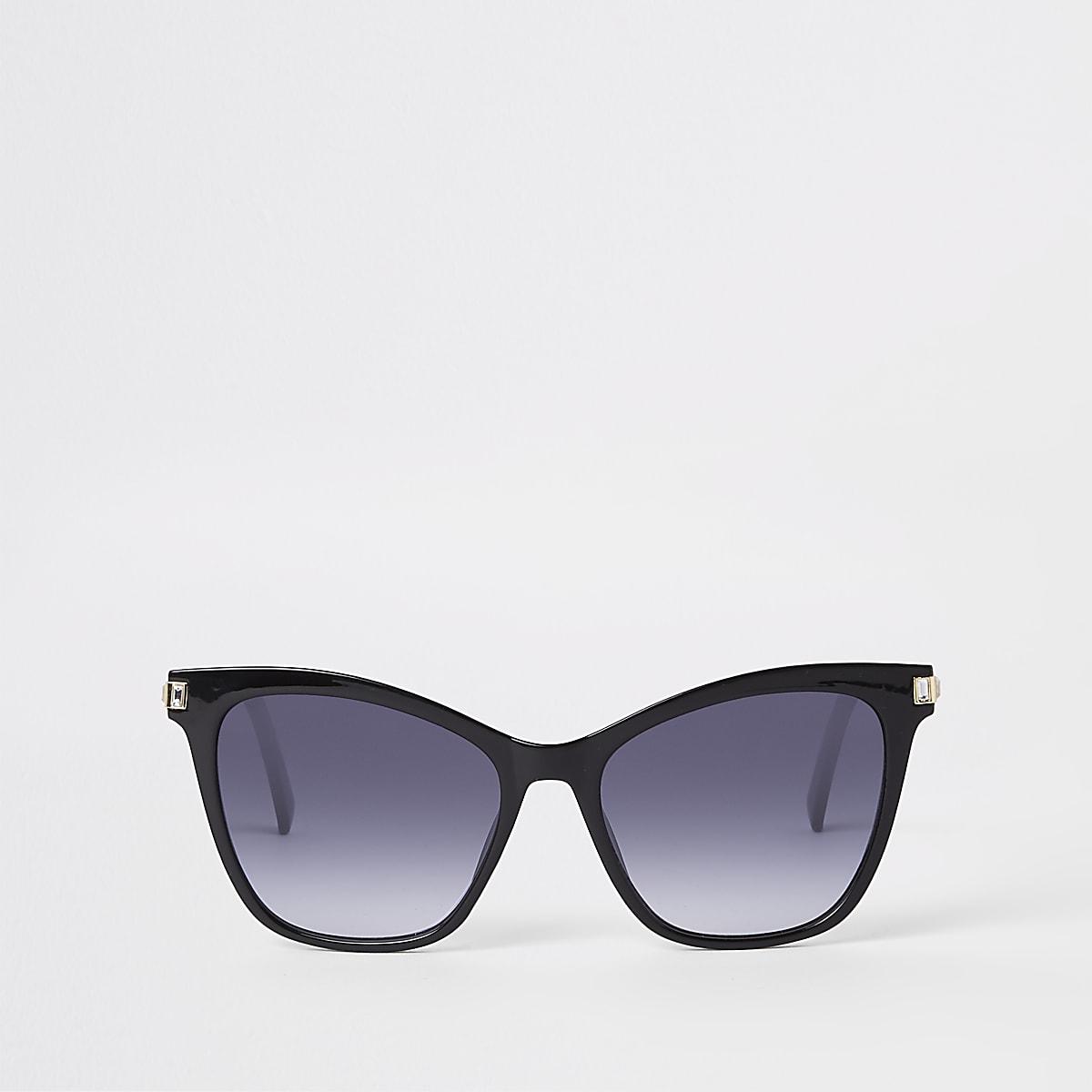 Zwarte zonnebril met siersteentjes op de rand