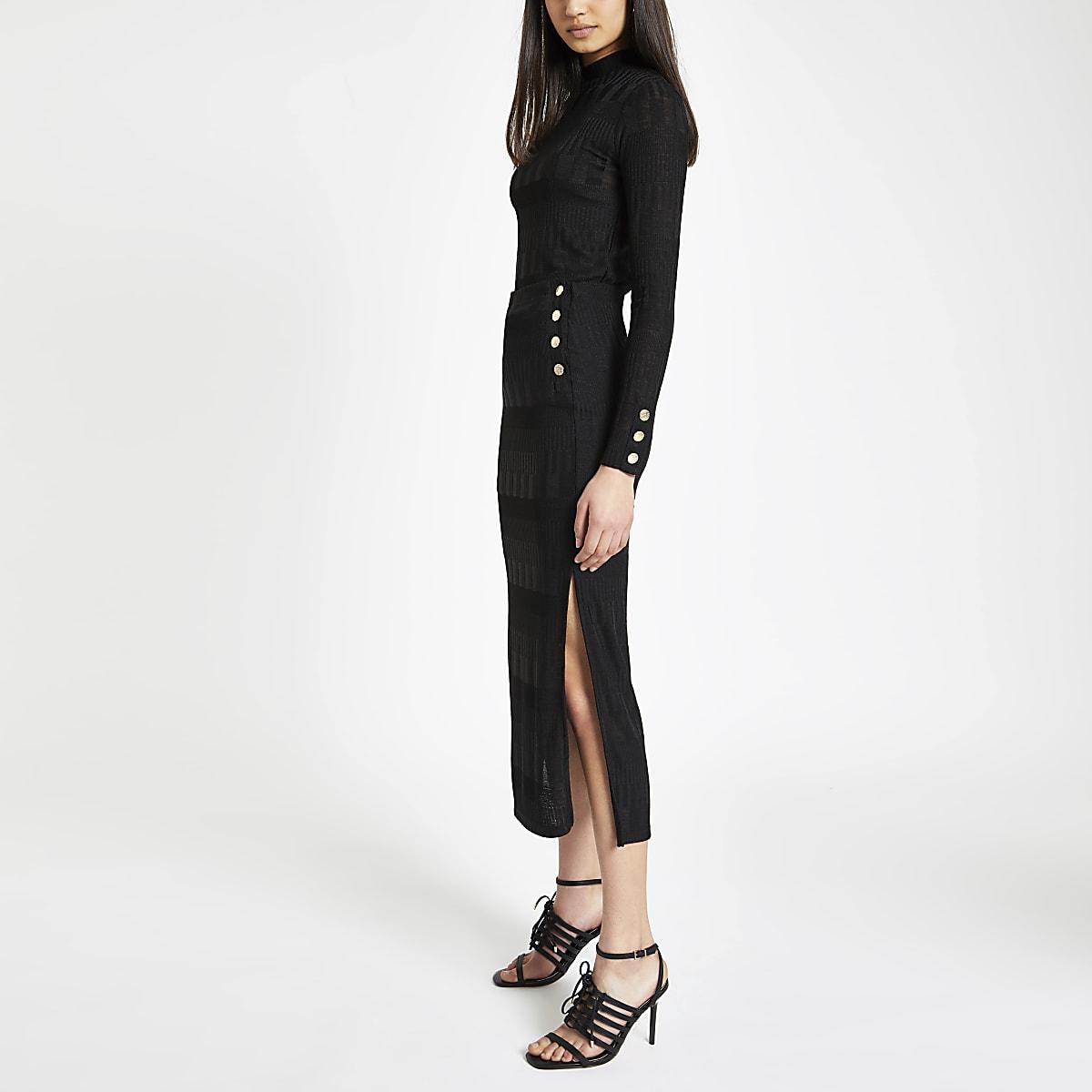 Jupe mi-longue en jersey noire à boutons sur le côté