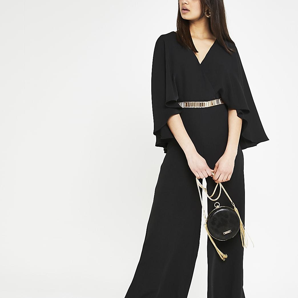 Zwarte jumpsuit met cape-mouwen en wijde pijpen