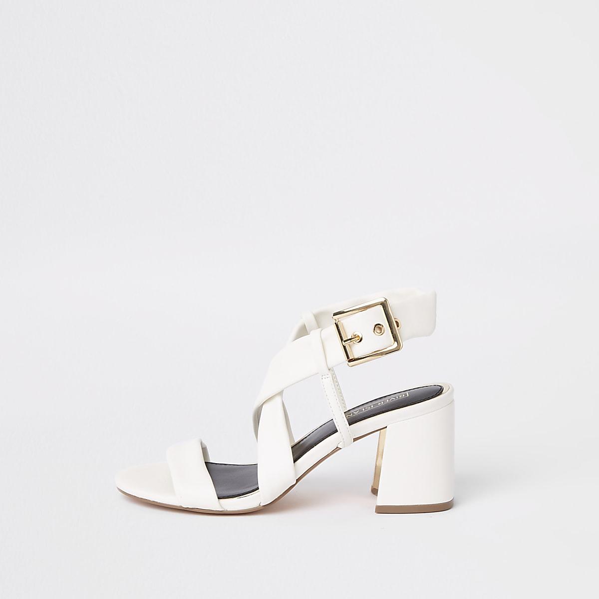 White strappy block heel sandals