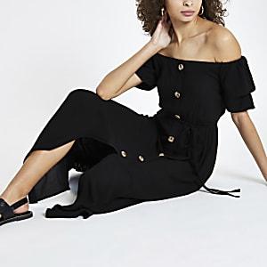 Zwarte maxi-bardotjurk met knopen voor