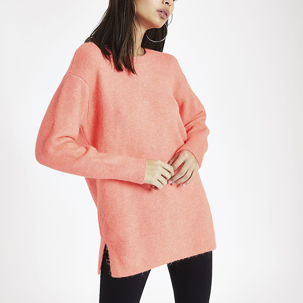 Bright orange knit crew neck sweater