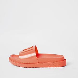 Claquettes en plastique orange fluo à logo RI fille