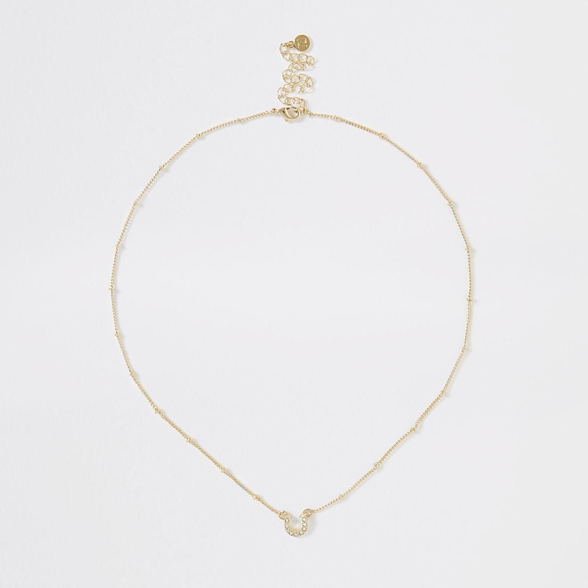 Gold color horse shoe necklace