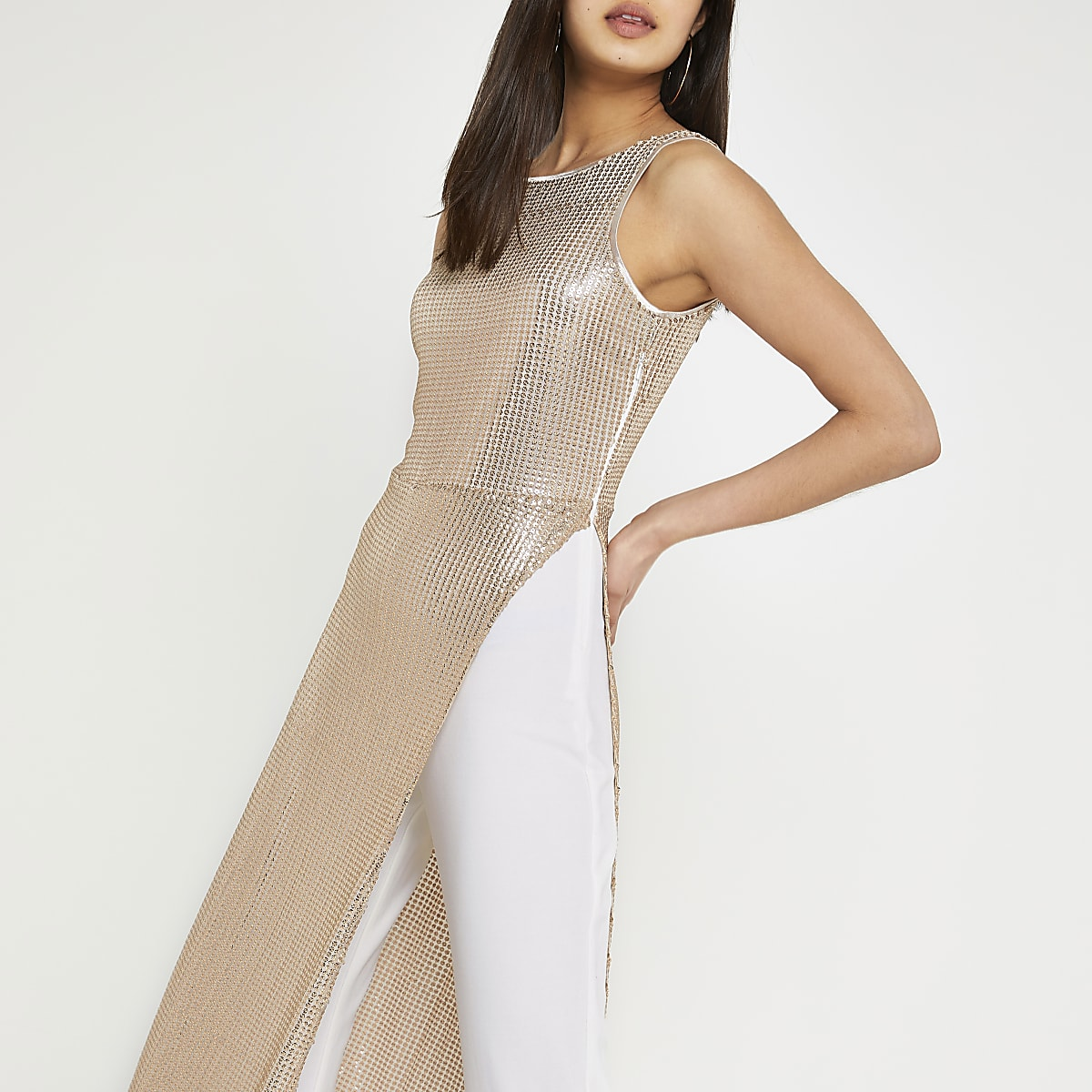 Gold sequin dress over trousers