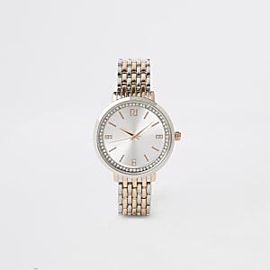 Horloge met drie metalen en diamantjes