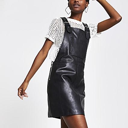 Black leather pinafore dress