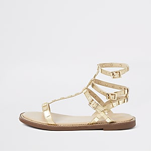Gold studded gladiator sandals