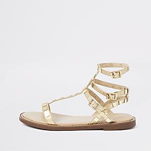Sandales gladiateur dorées cloutées