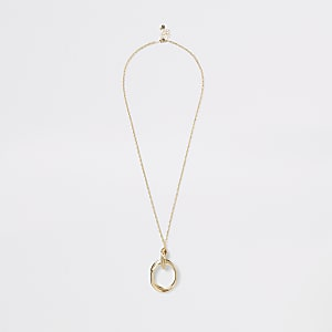 Goudkleurige lange ketting met cirkelvormige hanger