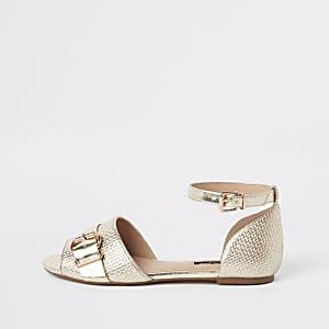 Goudkleurige schoenen met textuur en enkelbandje