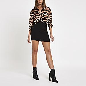 Black button mini skirt