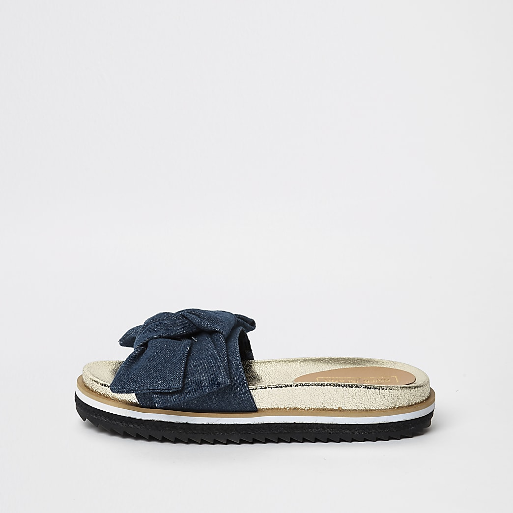 Blauwe denim slippers met strik voor